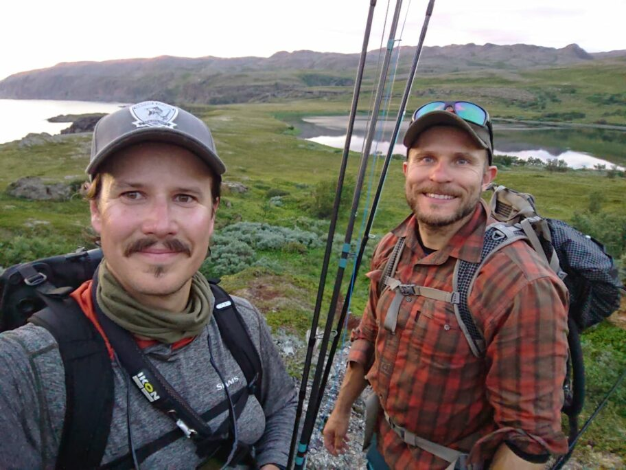 Santeri feeling happy on his way to a salmon pool with a friend
